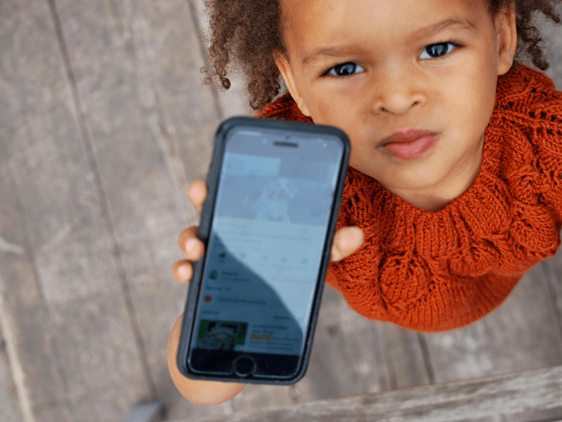 child with phone